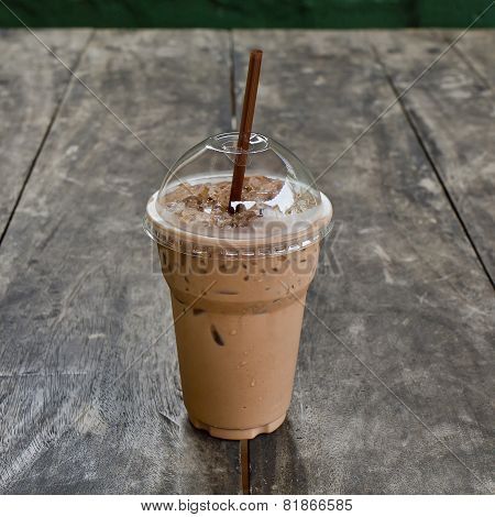 Cold Coffee Drink With Ice On Old Wood Table