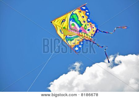 kite flying in а blue sky