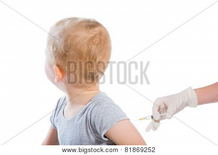The doctor makes a baby vaccination on a white background.