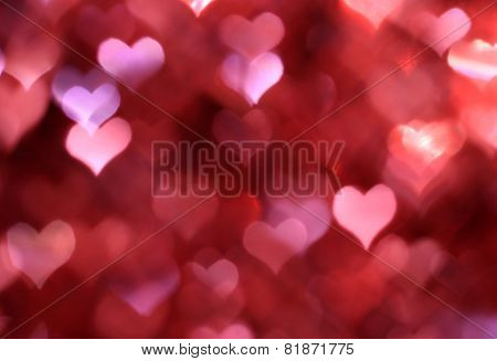 Abstract pink background with heart-shaped boke