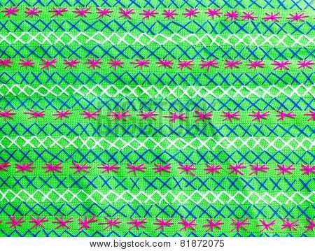 embroidered fabric texture background , green fabric