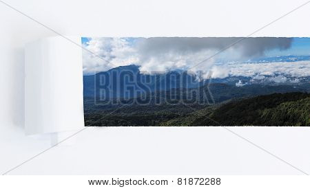 Tearing A Paper Frame Hole To Reveal Mountain And Sky Landscape