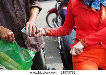 Vietnamese girl buys goods