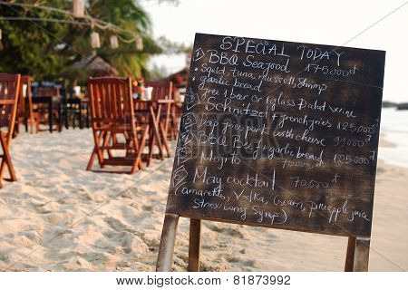 Restaurant menu board on the beach