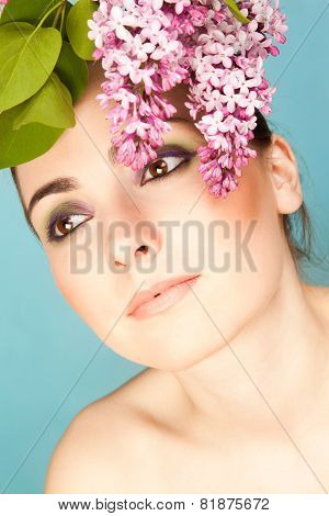 Portrait Of Beautiful Woman With Makeup And Branch Of Lilac
