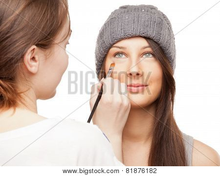 Make-up Artist Applying Makeup Onto Performer's Face
