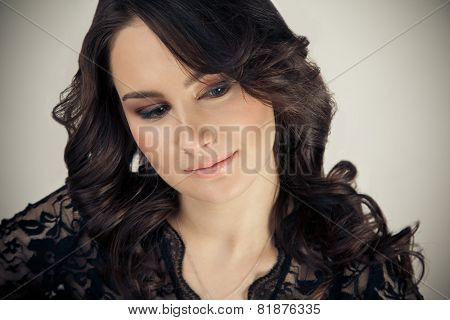 Portrait Of Beautiful Woman With Makeup And Evening Hairstyle