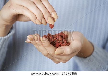 Close Up Of Woman Holding Handful Of Goji Berries