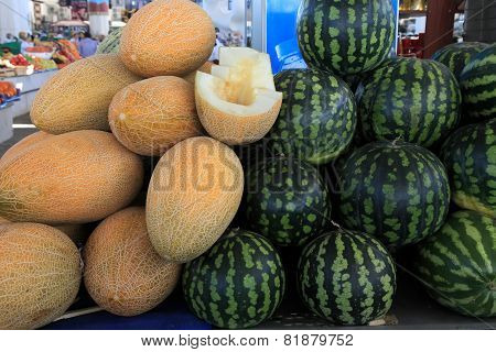 Ashgabad, Turkmenistan - October 15, 2014. Fragrant Sweet Melons And Watermelons On Closed Market In