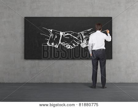 Businessman Drawing Handshake
