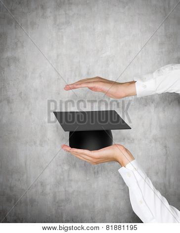 Hands Holding Bachelor Cap