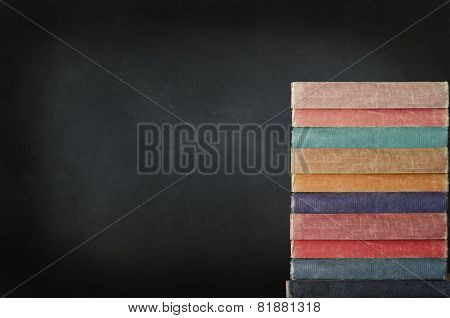 Stack Of Books With Chalkboard