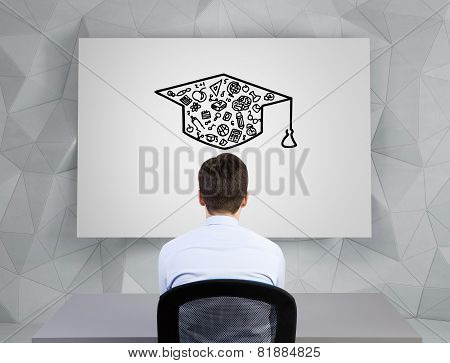 Businessman  Looking On Bachelor Cap