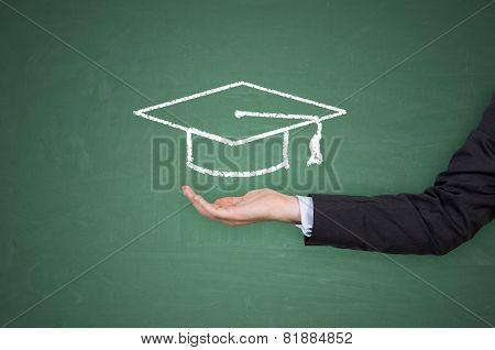 Hand Holding Bachelor Hat