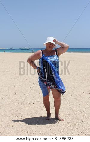 Mature woman enjoying her summer vacation dressed in bathing suit