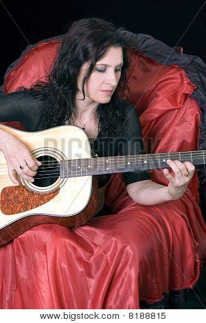 girl plays a guitar