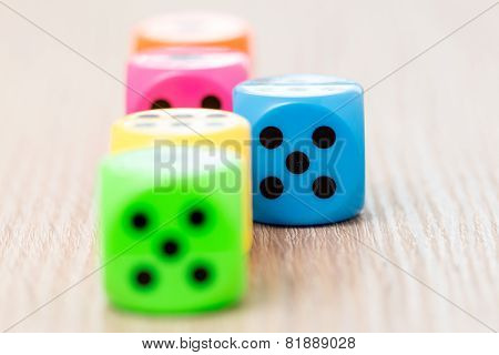 Colorful Dice On The Wooden Surface