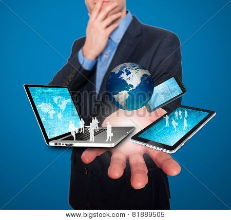 Businessman holds modern technology in hands - Stock Image