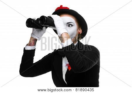Portrait of the searching mime with binoculars