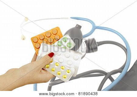 The Pills In The Hands Of The Doctor On The Background Of Medical Instruments