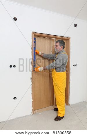 Builder Measure Verticality Of Door With Level Tool