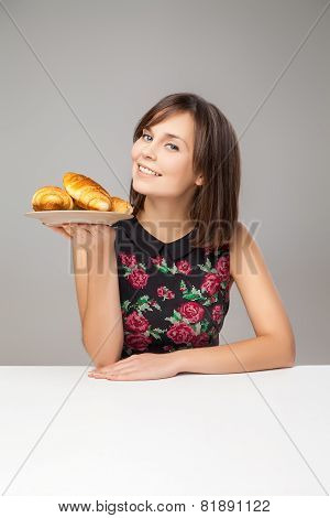 Healthy Young Woman With Croissants
