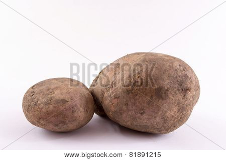 2 Simple looking potatoes on white background