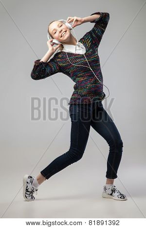 Girl With Headphones Singing and dancing