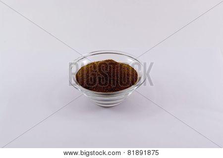 A single small glass bowl of chicory powder