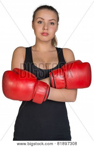 Woman in boxing gloves with her hands crossed on breast