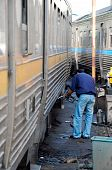 stock photo of railcar  - Staff is add fuel to the diesel railcar - JPG