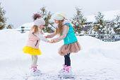 stock photo of skate  - Adorable little girls skating on ice - JPG