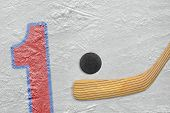 picture of hockey arena  - Hockey stick puck and the numeral one painted on the ice - JPG