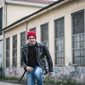 picture of anarchists  - Punk guy with beanie posing in the city streets - JPG