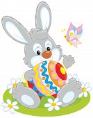 stock photo of cony  - Little rabbit sitting with a big decorated Easter egg - JPG