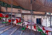 picture of canopy  - Italian outdoor cafe on the stairs under a canopy - JPG