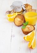 picture of bakeshop  - Healthy breakfast with muffinsjuiceorange and honey on a wooden background