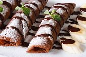 picture of crepes  - chocolate crepes with sauce and bananas close - JPG