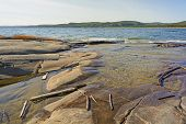 pic of driftwood  - Driftwood and Rocks on a Remote Shore in Neys Provincial Park in Ontario - JPG
