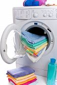 foto of cleaning agents  - washing machine isolated on white cleaning agents and cloths - JPG