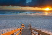 pic of sunrise  - Australian beach entry with stairs in foreground at sunrise  - JPG