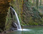 picture of water-mill  - Artificial waterfall passes through the ruins of a water mill in Tuscany - JPG