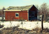 stock photo of shacks  - Fixer upper red shack on the side of the road in the winter. ** Note: Visible grain at 100%, best at smaller sizes - JPG