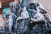 stock photo of shiva  - A plaster carving of the god Shiva sitting in meditation - JPG
