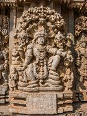 foto of karnataka  - A carving of the Hindu god Vishnu sitting beneath a tree at the 13th Century temple of Somanathapur - JPG