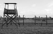 stock photo of deportation  - Sentry box at Auschwitz Birkenau concentration camp, Poland
