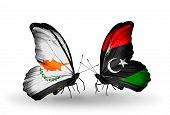 stock photo of libya  - Two butterflies with flags on wings as symbol of relations Cyprus and Libya - JPG
