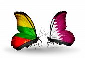 stock photo of qatar  - Two butterflies with flags on wings as symbol of relations Lithuania and Qatar - JPG