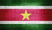 picture of suriname  - Grunge of Suriname flag on burlap fabric - JPG