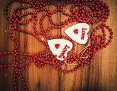 image of two hearts  - Two red hearts on wooden board Valentines Day - JPG
